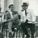 Richard Burton sitting with Walter Wanger. - 8x10 photo