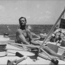 Eric Tabarly taking sunbath. - 8x10 photo