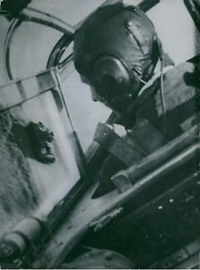 A view of the pilot maneuvering the plane. - 8x10 photo