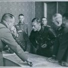 1939. German and Russian soldiers discuss the demarcation line in Poland. - 8x10