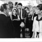 Audrey Hepburn speaking to a guest, in a function. - 8x10 photo