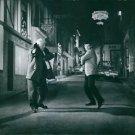 Jean Gabin and Jean Paul Belmondo dancing in street. - 8x10 photo