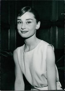 Audrey Hepburn looking at camera, smiling. - 8x10 photo
