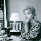 Still image of Jill Haworth writing on her desk. - 8x10 photo