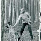 Jane Fonda with her dog. - 8x10 photo
