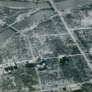 An aerial view of Japan after the atom bomb blast. - 8x10 photo