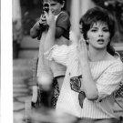 Gina Lollobrigida with child. - 8x10 photo