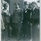Vintage photo of  Italian Blackshirt leader Italo Balbo standing and greeted by