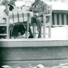 Winston Churchill sitting with his grand daughter,looking on water. - 8x10 photo
