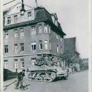 A light tank of  U.S. Army moves through the streets. - 8x10 photo
