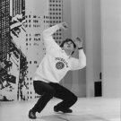 Évariste, in Princeton sweater, performing. - 8x10 photo