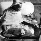 Mahatma Gandhi working - 8x10 photo