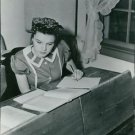 Judy Garland reading book and writing. - 8x10 photo