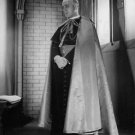 Alec Guinness standing. - 8x10 photo