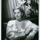 Arlene Dahl sitting. - 8x10 photo