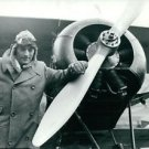 Gregory Peck stands by a biplane - 8x10 photo