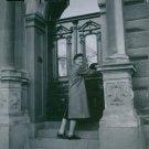 Portrait of  a Swedish nurse and philanthropist Elsa Brandstrom opening gate. 19