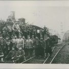 People gathered at the railway track and looking towards the camera during WWI.