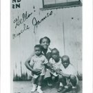 A woman sitting with her kids and Cassius Clay Jr(Muhammad Ali). - 8x10 photo