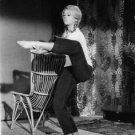 Jane Fonda doing acrobats. - 8x10 photo