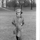 Jeane Moreau walking in the garden. - 8x10 photo