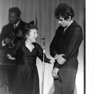 Edith Piaf on stage with her husband. - 8x10 photo