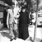 Jaime de Mora y Aragón walking with old man. - 8x10 photo