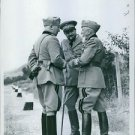 Italo Balbo standing and talking with two men, 1940. - 8x10 photo