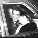 Dirk Bogarde and Romy Schneider laughing. - 8x10 photo