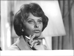 Sophia Loren holding cigarette. - 8x10 photo