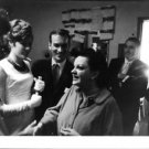 Judy Garland surrounded by people. - 8x10 photo