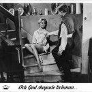Brigitte Bardot sitting on staircase.  - 8x10 photo
