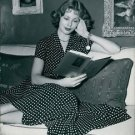 Arlene Dahl reading. - 8x10 photo