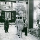 Staff welcoming guests upon entering the establishment in China.- 1967 - 8x10