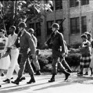 Soldiers and others citizens walking over street in Little rock in Arkansas - 8x