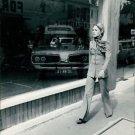 Brigitte Bardot walking on sidewalk.  - 8x10 photo