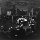 People gathered around John F. Kennedy's coffin.   - 8x10 photo