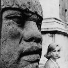 Ingrid Thulin posing with head of stautue. - 8x10 photo