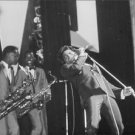 James Brown performing, with musicians. - 8x10 photo
