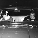 Audrey Hepburn inside a car, with man. - 8x10 photo