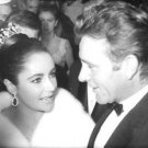 Elizabeth Taylor surrounded by people.  - 8x10 photo