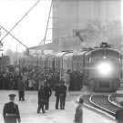 People waiting at a train station. - 8x10 photo