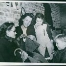A Belgian woman does her knitting as the others are watching. - 8x10 photo