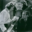 """Ingrid Bergman and Olof Georg Rydeberg in the scene of the 1938 movie. """"A Woman'"""