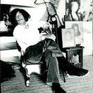 Salvador Dali sitting on chair.   - 8x10 photo