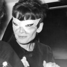 Audrey Hepburn wearing a mask. - 8x10 photo