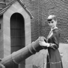 Audrey Hepburn holding a canon. - 8x10 photo
