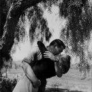 Clark Gable embracing Greer Garson. - 8x10 photo