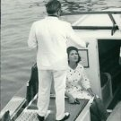 Maria Callas in a boat. - 8x10 photo