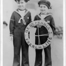 Charlie Chaplin's sons smiling.  - 8x10 photo